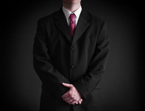 Image: Man wearing pink tie.