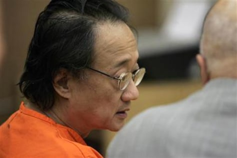 Image: Norman Hsu (L) speaks with his attorney, James Brosnahan, inside a courtroom in Redwood City