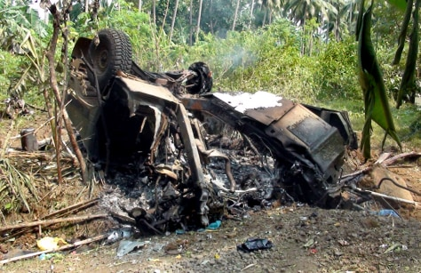 Image: a smoldering humvee remains after two U.S. soldiers were killed