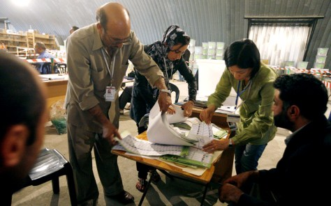 Image: Election workers recount votes