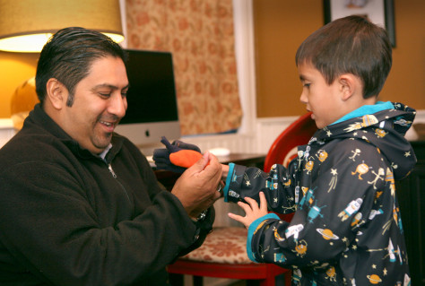 "Image: Image: Steve Flores prepares son Joaquin, ""Quino,"" age 6, for school."