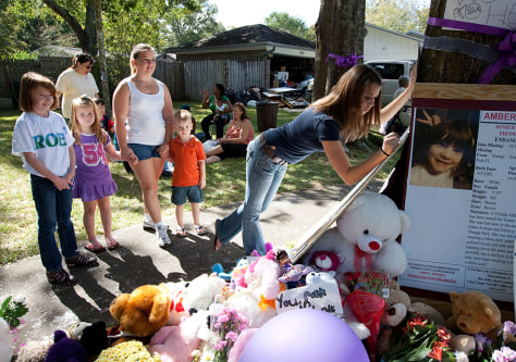 Image: neighbors pay respects at a memorial to Somer Thompson