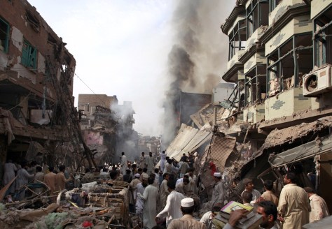 Image: Residents, rescue workers and security officials gather after a bomb explosion in Peshawar