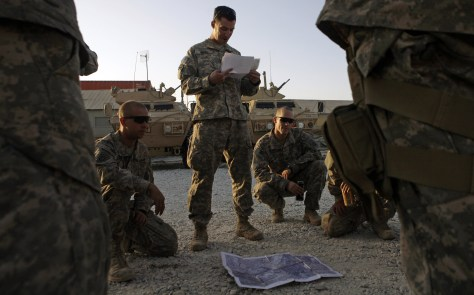 Image: U.S. Army Lt. Jonathan Smith, center, from Garland, Texas, conducts a mission brief with his platoon from Bravo Co., Division Special Troops Battalion, 82nd Airborne Division, at Bagram Air Field