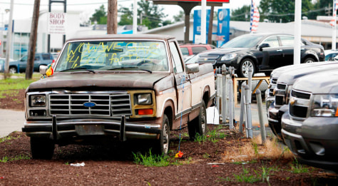 Image: A Ford F150 clunker