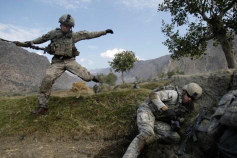 Image: Cpl. Casey Liffrig leaps during an ambush