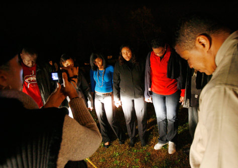 Image: Family members of convicted sniper John Allen Muhammad pray in Jarratt, Va.