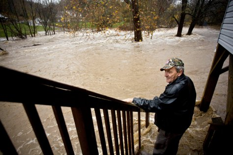 Image: Man looking at flood