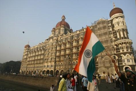 Image: A man with Indian national flag nearTaj Mahal hotel in Mumbai