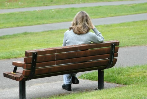 Image: Woman sitting alone on a bench