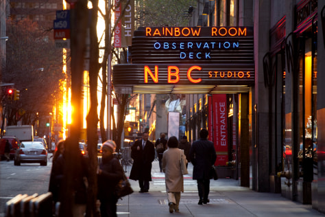 Image: Pedestrians walk outside NBC Studios