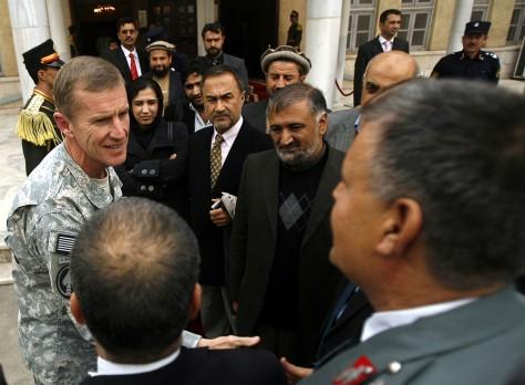 Image: General Stanley McChrystal greets Afghan parliament members in Kabul, Afghanistan