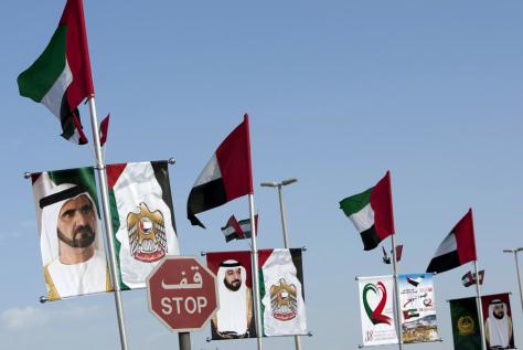 Image: UAE President Sheikh Khalifa and Sheikh Mohammed bin Rashid Al Maktoum adorn flags