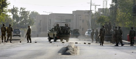 Image: Troops search close to the site of suicide attack