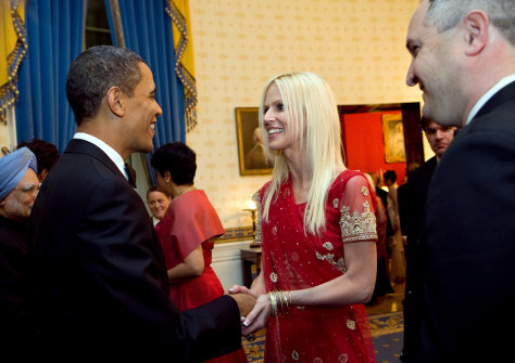 Image: Barack Obama meets gate crashers, Michaele and Tareq Salahi