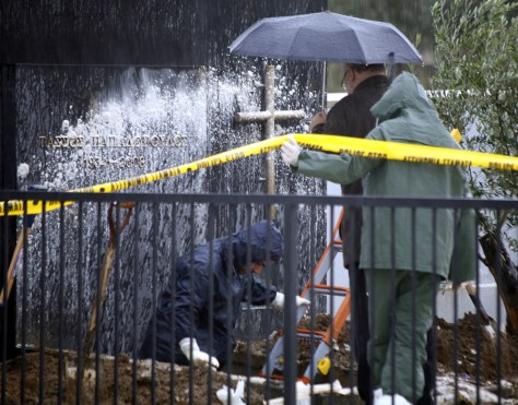 Image: Police investigate near the grave of former Cyprus President Tassos Papadopoulos