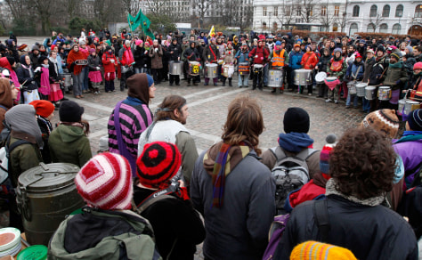 Image: Several hundred demonstrators warm up before a march in Copenhagen, on Monday.