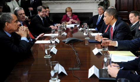 Image: Obama speaks with members of financial services industries
