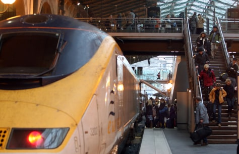 Image: Passengers board a Eurostar train at the Gare du Nord station in Paris