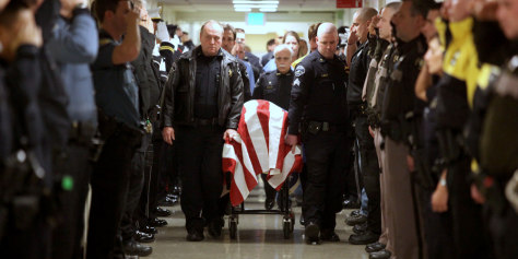Image: Officers pay respects to fellow officer Kent Mundell