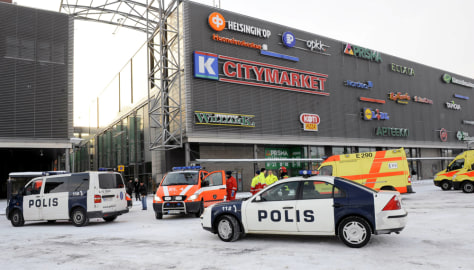Image: Emergency vehicles are parked outside the Sello shopping center in Finland.