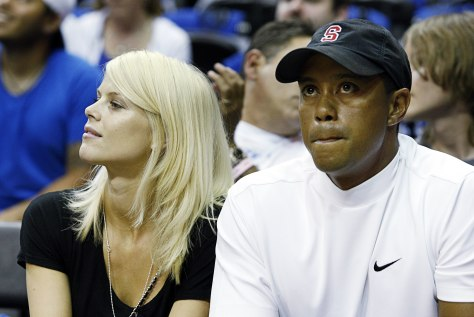 Image: Tiger Woods and his wife Elin Nordegren watch Game 4 of the NBA Finals basketball game in Orlando