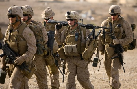 Image: U.S. Marines from India Company, 3rd Battalion 4th Marines, walk as they go for a mission
