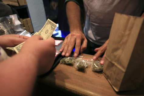 Image: A person buys medical marijuana in Oakland, Calif.