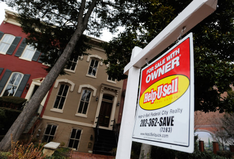 Image: A sign marks a house for sale by the owner in the Capitol Hill neighborhood in Washington