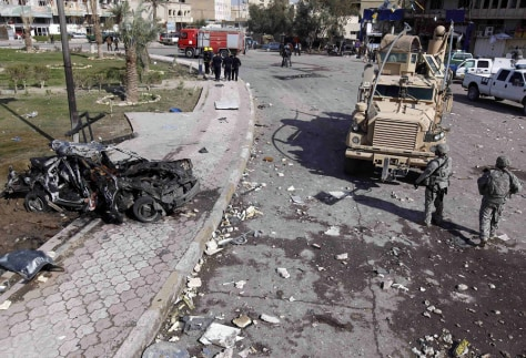 Image: Site of a car bomb attack in central Baghdad