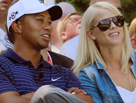 Image: Tiger Woods with his wife Elin Nordegren