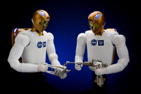 "Image: Two ""Robonaut2"" robots"