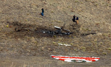 Image: Investigators survey the scene of a midair accident