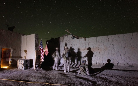 Image: U.S. Marines with Alpha Company gather before a night mission