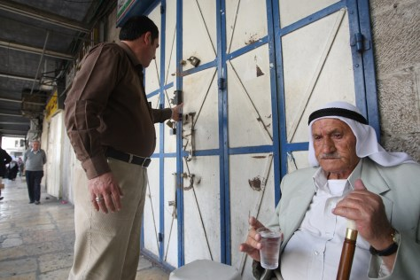 Image: An elderly man drinks water in Jerusalem