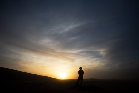 Image: A marine stands guard at sunset