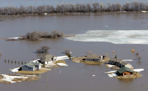 Image: Homes in the Lake Shore subdivision are surrounded by flood waters