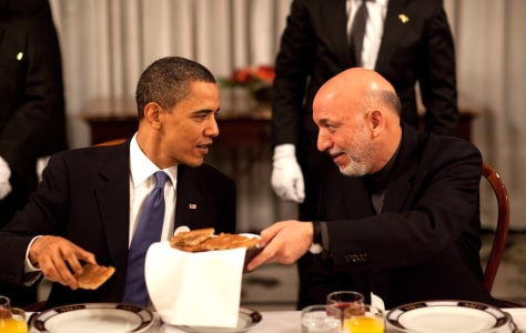 Image: President Hamid Karzai chats with President Barack Obama