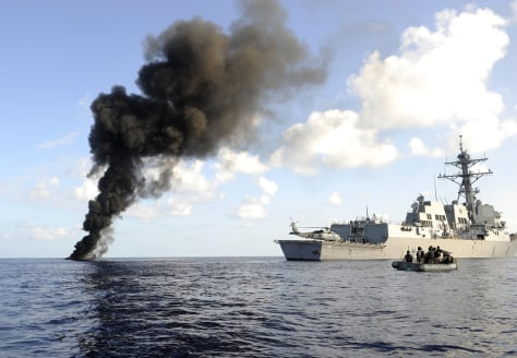 Image: Pirate skiff burns next to the USS Farragut