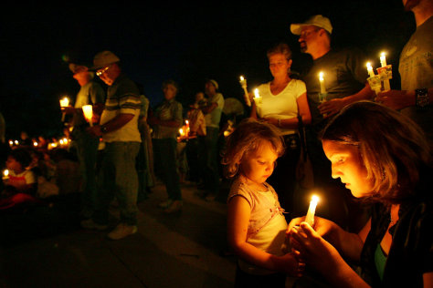 Image: A candlelight vigil for six local coal miners