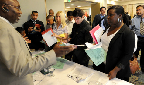 Image: Unemployed Americans speak with James Berry (L) from Goodwill Industries in L.A. in March, 2010. An AP survey of economists says jobs and housing prices will remain sluggish into next year.