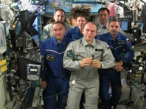 Image: Members of the Expedition 23 crew talk with Russian President Dmitry Medvedev from the International Space Station
