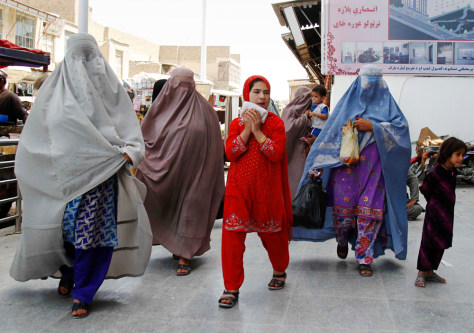 Image: Afghan women walk in downtown Kandahar city