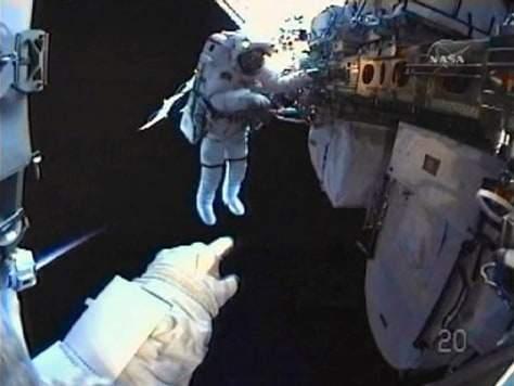 Image: Space Shuttle Discovery astronaut Rick Mastracchio works in this view from Clayton Anderson's helmet camera
