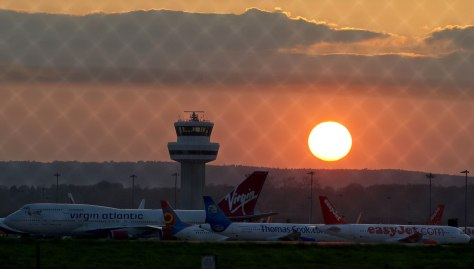 Image: Reddish sunset at closed London airport