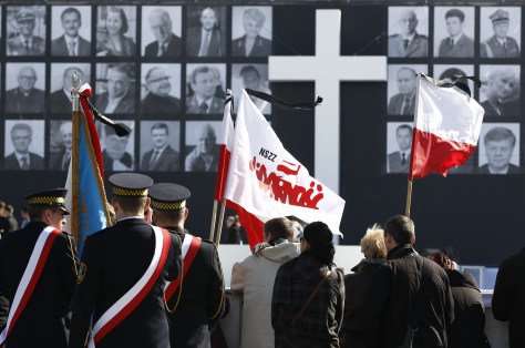 Image: People wait for the start of a commemoration service for late Polish President Lech Kaczynski and the other plane crash victims