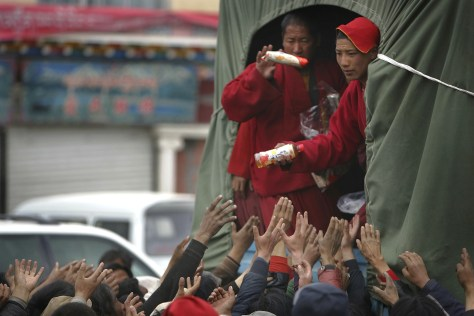 Image: Buddhist monks distribute aid