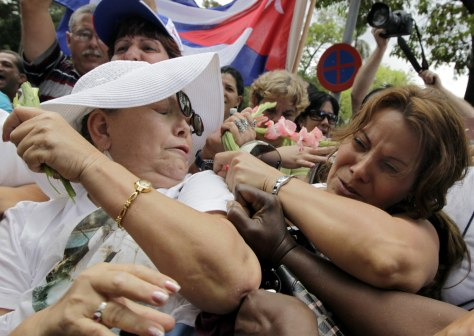 Image: Members of the Ladies in White struggle with pro-government supporters in Havana