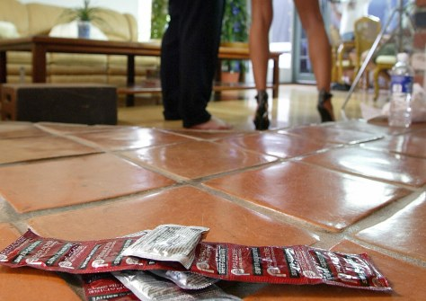 Packages of condoms (foreground) are rea