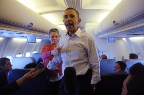 Image: President Barack Obama speaks with traveling journalists on board Air Force One